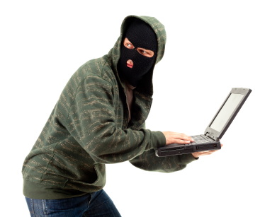 Man stealing data from a laptop iStock_000013972877XSmall.jpg